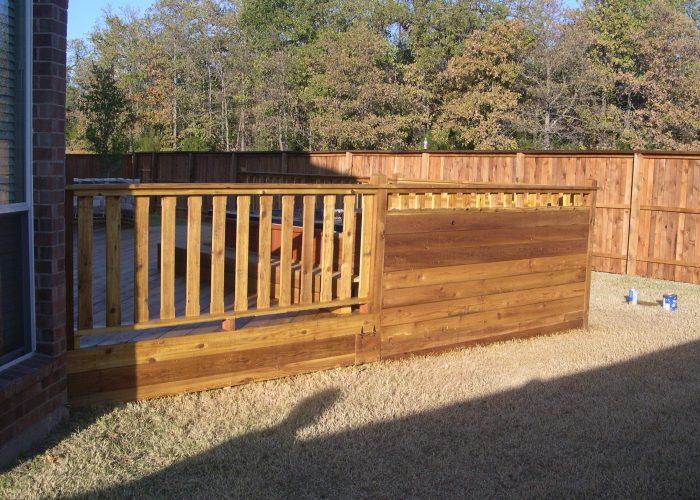custom deck surrounding a hot tub